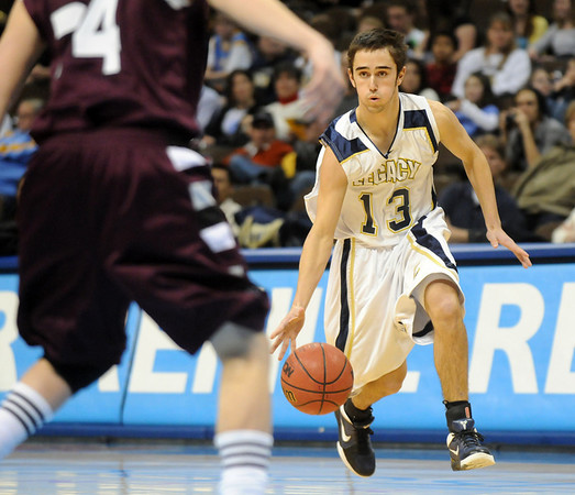 Legacy's Justin Muench takes the ball down court during Wednesday's game against Horizon at the Pepsi Center in Denver.<br /> <br /> <br /> January 13, 2010<br /> Staff photo/David R. Jennings