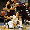 Legacy's Nate Pickens, left, tries to pass the ball around Horizon's Jesse Torres during Wednesday's game at the Pepsi Center in Denver.<br /> <br /> <br /> January 13, 2010<br /> Staff photo/David R. Jennings