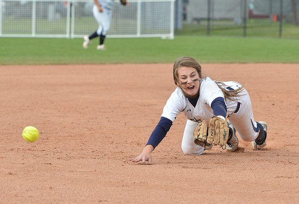 Legacy's Paige Reichmuth tries to get a ball hit by Loveland during Saturday's state semi final 5A softball championship game at Aurora Sports Park.<br /> <br /> October 20, 2012<br /> staff photo/ David R. Jennings