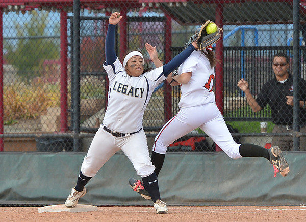 Legacy's Angelique Archuleta tags out Loveland's Skylar Beard at first base during Saturday's state semi final 5A softball championship game at Aurora Sports Park.<br /> <br /> October 20, 2012<br /> staff photo/ David R. Jennings