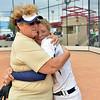 Dawn Gaffin comforts Bekka Prokaski after the Lightning lost to Loveland in Saturday's state semi final softball championships at Aurora Sports Park.<br /> <br /> October 19, 2012<br /> staff photo/ David R. Jennings