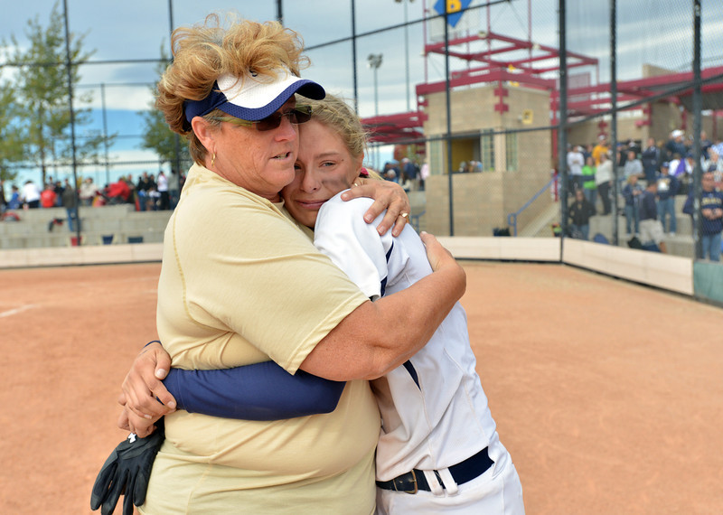 Dawn Gaffin comforts Bekka Prokaski after the Lightning lost to Loveland in Saturday's state semi final softball championships at Aurora Sports Park.<br /> <br /> October 19, 2012<br /> staff photo/ David R. Jennings