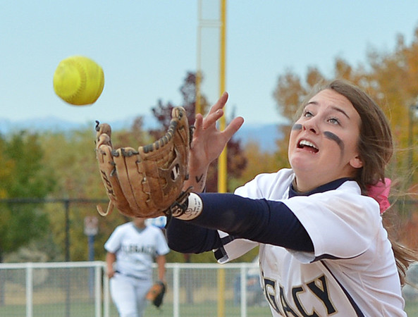 Legacy's Paige Riechmuth reaches for a fly ball hit by Loveland during Saturday's state semi final 5A softball championship game at Aurora Sports Park.<br /> <br /> October 20, 2012<br /> staff photo/ David R. Jennings