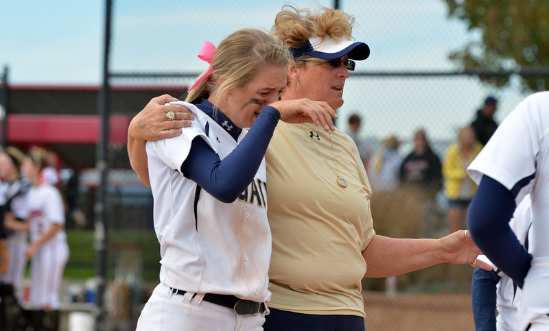 Legacy's coach Dawn Gaffin comforts Bekka Prokaski after the Lightning lost to Loveland in Saturday's state semi final softball championships at Aurora Sports Park.<br /> <br /> October 19, 2012<br /> staff photo/ David R. Jennings