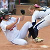 Loveland's Bradey King slides safely to third base against Legacy's Kylie Barnard during Saturday's state semi final softball championships at Aurora Sports Park.<br /> <br /> October 19, 2012<br /> staff photo/ David R. Jennings
