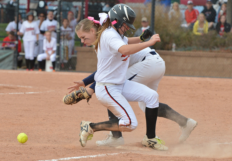 Legacy's Kylie Barnard goes after the ball after Loveland's Colissa Bakovich stays safe at third base during Saturday's state semi final 5A softball championship game at Aurora Sports Park.<br /> <br /> October 20, 2012<br /> staff photo/ David R. Jennings
