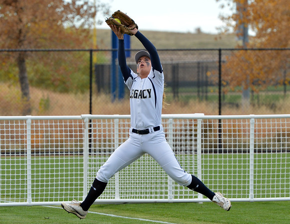 Legacy's Mariah Latham catches a ball in the outfield hit by Loveland during Saturday's state semi final softball championships at Aurora Sports Park.<br /> <br /> October 19, 2012<br /> staff photo/ David R. Jennings