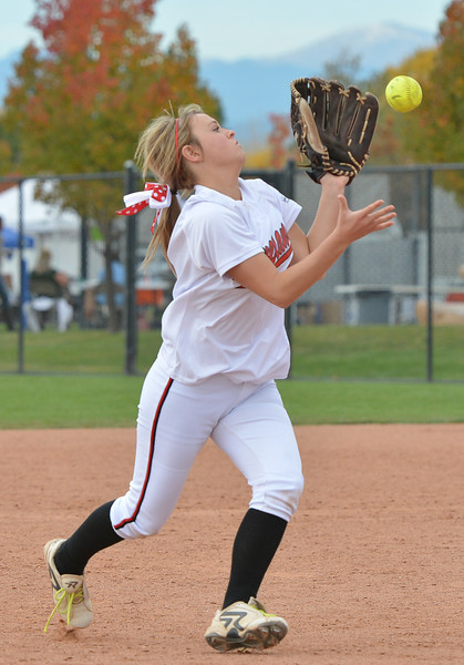Loveland's Bradey King catches a ball hit by Legacy during Saturday's state semi final 5A softball championship game at Aurora Sports Park.<br /> <br /> October 20, 2012<br /> staff photo/ David R. Jennings
