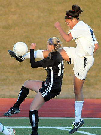 Legacy's Sade Akindele kicks the ball away from <br /> Gina Ogg, Monarch during Friday's game at North Stadium.<br /> <br /> April 9, 2010<br /> Staff photo/David R. Jennings