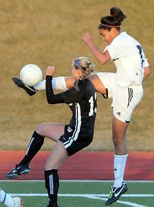 Legacy's Sade Akindele kicks the ball away from  Gina Ogg, Monarch during Friday's game at North Stadium.  April 9, 2010 Staff photo/David R. Jennings