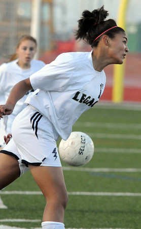 Legacy's Sade Skindele does a header downfield against Monarch during Friday's game at North Stadium.<br /> <br /> April 9, 2010<br /> Staff photo/David R. Jennings