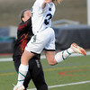 Legacy's Brienne Garside does a header against Monarch's goalie Sam Auday during Friday's game at North Stadium.<br /> <br /> April 9, 2010<br /> Staff photo/David R. Jennings