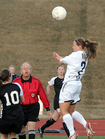 Legacy's Tara Bice does a header over Monarch during Friday's game at North Stadium.<br /> <br /> April 9, 2010<br /> Staff photo/David R. Jennings