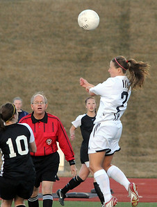 Legacy's Tara Bice does a header over Monarch during Friday's game at North Stadium.  April 9, 2010 Staff photo/David R. Jennings