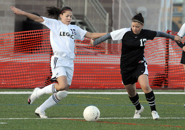Legacy's Taylor Archuleta fights for control of the ball with Hannah Stimac, Monarch during Friday's game at North Stadium.<br /> <br /> April 9, 2010<br /> Staff photo/David R. Jennings