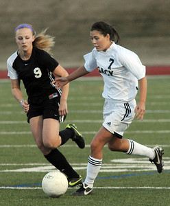 Legacy's Bree Archuleta drives the ball past Monarch's Haley Schumacher during Friday's game at North Stadium.  April 9, 2010 Staff photo/David R. Jennings