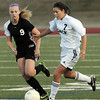 Legacy's Bree Archuleta drives the ball past Monarch's Haley Schumacher during Friday's game at North Stadium.<br /> <br /> April 9, 2010<br /> Staff photo/David R. Jennings