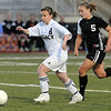 Legacy's Jesse Arellano takes the ball downfield ahead of Carly Bolyard, Monarch during Friday's game at North Stadium.<br /> <br /> April 9, 2010<br /> Staff photo/David R. Jennings