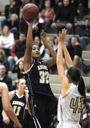 Legacy's Sade Akindele shoots for two against Monarch's Eliza Norman during Tuesday's game at Monarch.<br /> January 18, 2011<br /> staff photo/David R. Jennings