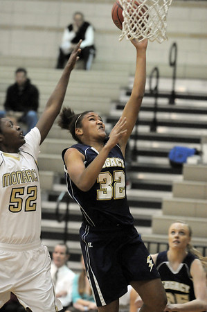 Legacy's Sade Akindele goes to the basket past Monarch's Alexus Johnson during Tuesday's game at Monarch.<br /> January 18, 2011<br /> staff photo/David R. Jennings