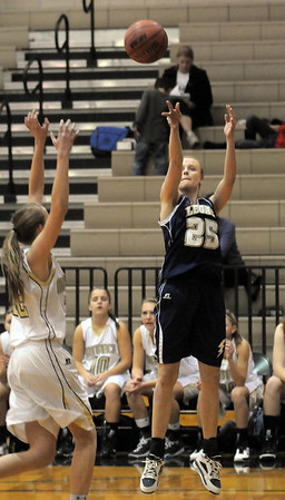 Legacy's Sarah Dunahay shoots for three against Monarch during Tuesday's game at Monarch.<br /> January 18, 2011<br /> staff photo/David R. Jennings