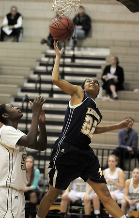 Legacy's Kailey Edwards goes to the basket past Monarch's Alexus Johnson during Tuesday's game at Monarch.<br /> January 18, 2011<br /> staff photo/David R. Jennings