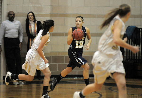 Legacy's Taylor Archuleta drives the ball down court against Monarch during Tuesday's game at Monarch.<br /> January 18, 2011<br /> staff photo/David R. Jennings