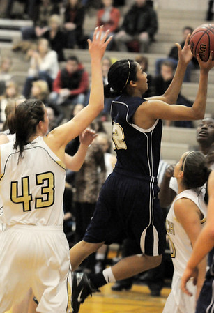Legacy's Kailey Edwards goes up for two past Monarch's Eliza Norman during Tuesday's game at Monarch.<br /> January 18, 2011<br /> staff photo/David R. Jennings