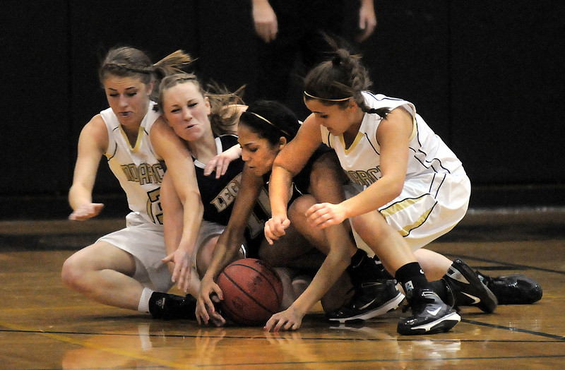 Emily Glen and Taylor Archuleta, Legacy  pileup with Ashton Davis and Ellie Dietz, Monarch as they scramble for a loose during Tuesday's game at Monarch.<br /> January 18, 2011<br /> staff photo/David R. Jennings