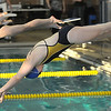 Legacy's Brittany Holloway launches off the starting blocks for the 50 meter freestyle event during the meet against Monarch at the Louisville Recreation Center on Friday.<br /> <br /> January 15, 2010<br /> Staff photo/David R. Jennings