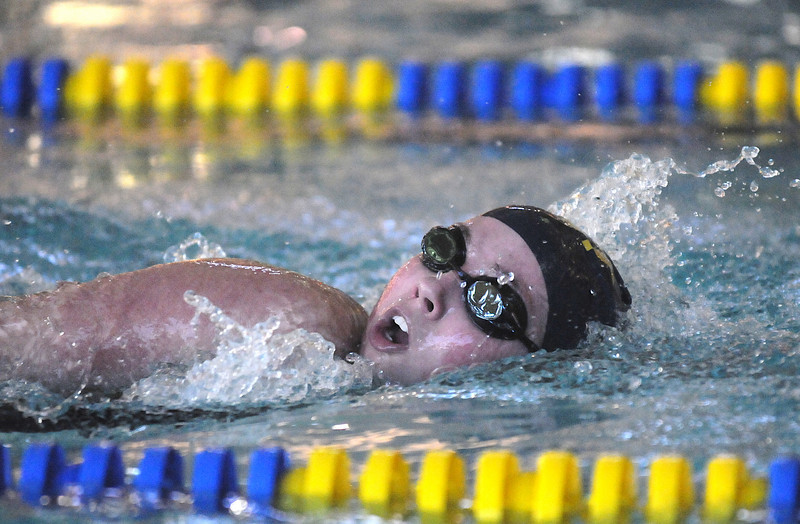 Legacy's Alek Johnson swimming in the 200 meter freestyle event  during the meet against Monarch at the Louisville Recreation Center on Friday.<br /> <br /> <br /> January 15, 2010<br /> Staff photo/David R. Jennings