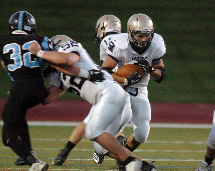 BE0919LFOOT03<br /> Dezmon Fernandez, Legacy, carries the ball through the line during Friday's game against Moutain Range at North Stadium in Westminster<br /> <br /> September 17, 2010<br /> staff photo/David R. Jennings