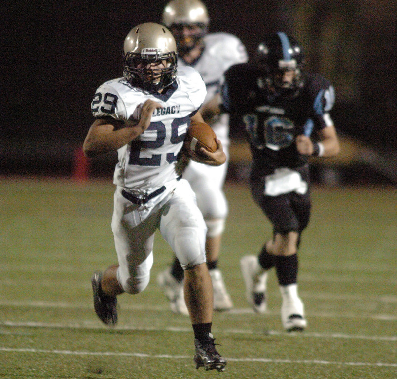 BE0919LFOOT08<br /> Eddie Schroder, Legacy, carries the ball downfield during Friday's game against Moutain Range at North Stadium in Westminster<br /> <br /> September 17, 2010<br /> staff photo/David R. Jennings