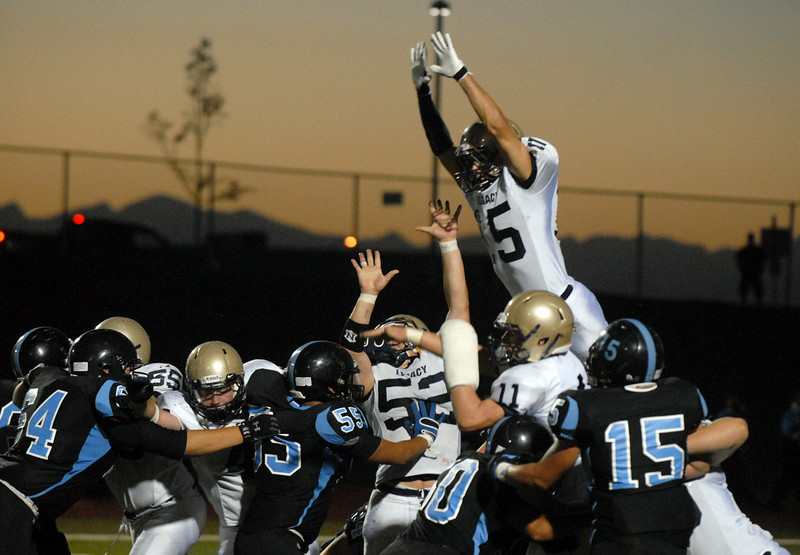 BE0919LFOOT14<br /> Legacy's Mason Doubleday jumps to try to block a kick during Friday's game against Mountain Range at North Stadium in Westminster<br /> <br /> September 17, 2010<br /> staff photo/David R. Jennings