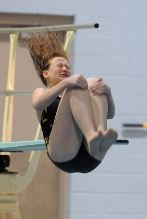 Legacy's Kelsey Dowd performs a dive during the swim meet against Mountain Range at the Veteran's Memorial Aquatic Center on Thursday.<br /> For more photos please see the broomfieldenterprise.com<br /> December 1, 2011<br /> staff photo/ David R. Jennings