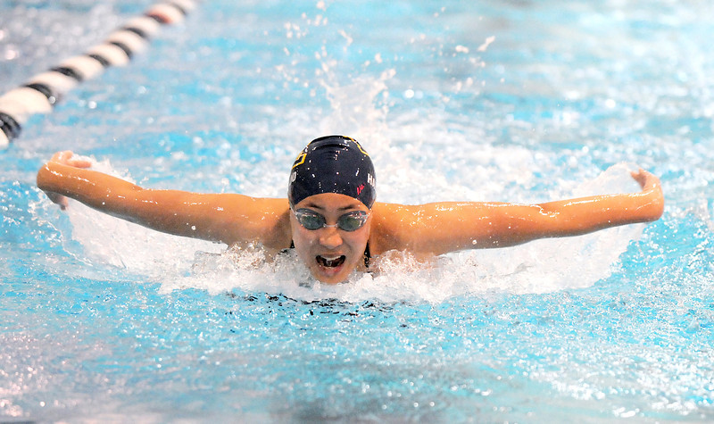 Elysia Hartojo swims in the 100 yard butterfly during the swim meet against Mountain Range at the Veteran's Memorial Aquatic Center on Thursday.<br /> For more photos please see the broomfieldenterprise.com<br /> December 1, 2011<br /> staff photo/ David R. Jennings