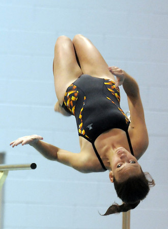 Legacy's Callyn Shelly performs a dive during the swim meet against Mountain Range at the Veteran's Memorial Aquatic Center on Thursday.<br /> For more photos please see the broomfieldenterprise.com<br /> December 1, 2011<br /> staff photo/ David R. Jennings