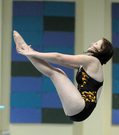 Alyssa Werner performs a dive during the swim meet against Mountain Range at the Veteran's Memorial Aquatic Center on Thursday.<br /> For more photos please see the broomfieldenterprise.com<br /> December 1, 2011<br /> staff photo/ David R. Jennings