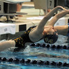 Legacy's Danielle Garside begins the 100 yard backstroke during the swim meet against Mountain Range at the Veteran's Memorial Aquatic Center on Thursday.<br /> For more photos please see the broomfieldenterprise.com<br /> December 1, 2011<br /> staff photo/ David R. Jennings
