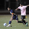 Aaron Thomas, left, Legacy, keeps the ball from Brandon Morales, Mountain Range during Tuesday's game at North Stadium.<br /> <br /> October 13, 2009<br /> Staff photo/David R. Jennings