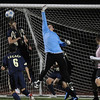 Keeper Christian Rivera, center, Legacy,tries to block the ball after a shot on goal from  Mountain Range during Tuesday's game at North Stadium.<br /> <br /> October 13, 2009<br /> Staff photo/David R. Jennings