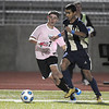 Legacy's, Paul Guzman advances on the ball with Mountain Range's Cole Nielsen during Tuesday's game at North Stadium.<br /> <br /> October 13, 2009<br /> Staff photo/David R. Jennings