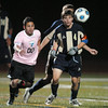 Tim Mooney, right, Legacy, chases after the ball against Christian Caruso, Mountain Range during Tuesday's game at North Stadium.<br /> October 13, 2009<br /> Staff photo/David R. Jennings