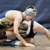 Legacy's Conner Casady, top, wrestles Mountain Ranges' Joel Geers in the 160-pound match on Thursday at Legacy.<br /> January 17, 2013<br /> staff photo/ David R. Jennings