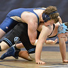 Legacy's Luke Robinson, top,wrestles Mountain Ranges' Brandon Forney in the 195-pound match on Thursday at Legacy.<br /> January 17, 2013<br /> staff photo/ David R. Jennings