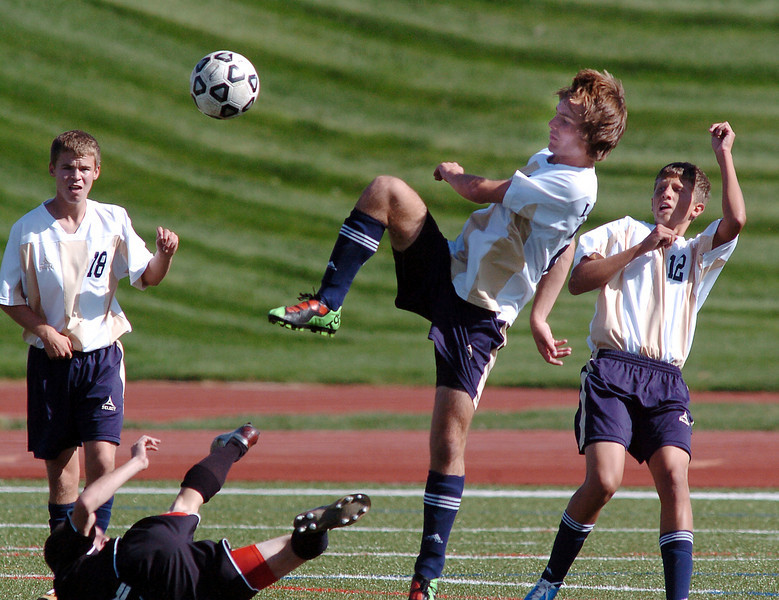 Tommy Brown, center, Legacy, high kick the ball past Prairie View during Wednesday's game at North Stadium.<br /> <br /> September 9, 2010<br /> staff photo/David R. Jennings