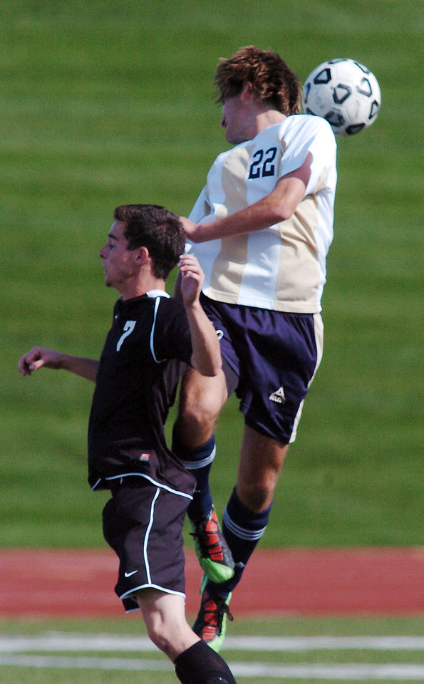 Tommy Brown, Legacy does a header past Tristan Sorenson, Prairie View during Wednesday's game at North Stadium.<br /> <br /> September 9, 2010<br /> staff photo/David R. Jennings