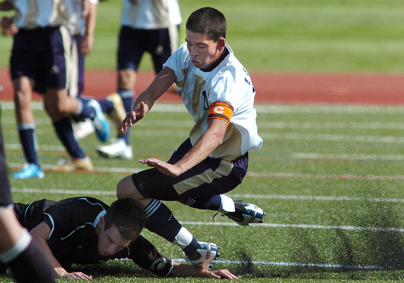 Hugo Aguirre, Legacy, collides with Tristan Sorenson, Prairie View, while going for the ball during Wednesday's game at North Stadium.<br /> <br /> September 9, 2010<br /> staff photo/David R. Jennings