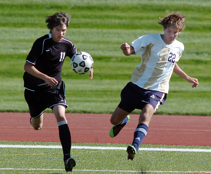 Tommy Brown, Legacy, kicks the ball past Jordan Del Ross, Prairie View during Wednesday's game at North Stadium.<br /> <br /> September 9, 2010<br /> staff photo/David R. Jennings