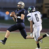 Legacy's quarterback Patrick Medina prepares to pass on the run against Overland's Jaylen McDonald during Thursday's game at North Stadium.<br /> September 1, 2011<br /> staff photo/ David R. Jennings